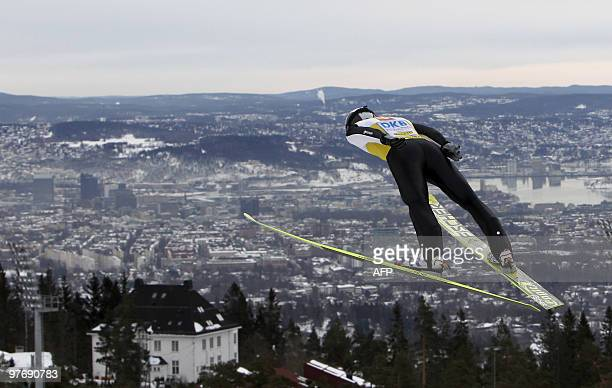France's Jason Lamy Chappuis soars through the air during the ski jumping event of the FIS Nordic Combined World Cup in Holmenkollen Oslo on March 14...