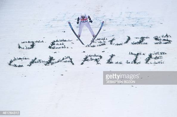 France's Jason Lamy Chappuis soars through the air over a message that reads 'Je suis Charlie' in reference to an attack by gunmen in which 12 people...