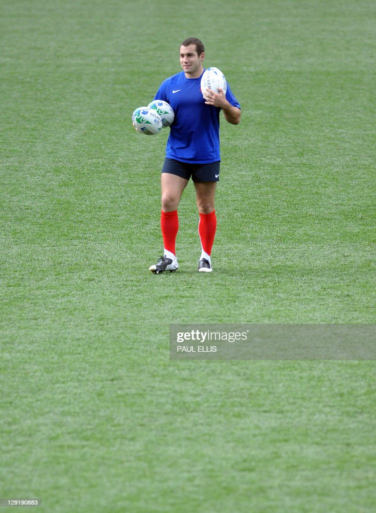 France's Jean Marc Doussain carries the balls during the captain's run at Eden Park stadium in Auckland on October 14, 2011 on the eve of their 2011 Rugby World Cup semi-final match against Wales.