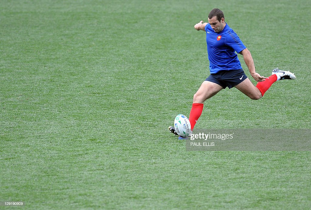 France's Jean Marc Doussain kicks a ball during the captain's run at Eden Park stadium in Auckland on October 14, 2011 on the eve of their 2011 Rugby World Cup semi-final match against Wales.