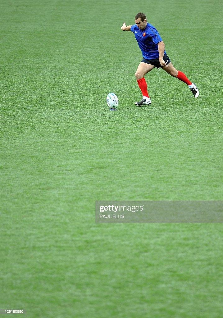 France's Jean Marc Doussain kicks the balls during the captain's run at Eden Park stadium in Auckland on October 14, 2011 on the eve of their 2011 Rugby World Cup semi-final match against Wales.