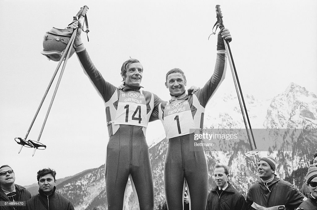 France's <a gi-track='captionPersonalityLinkClicked' href=/galleries/search?phrase=Jean-Claude+Killy&family=editorial&specificpeople=223880 ng-click='$event.stopPropagation()'>Jean-Claude Killy</a> (left) and Guy Perillat celebrate their performances in the men's downhill ski event at the 1968 Winter Olympics in Grenoble. Killy won the gold medal and Perillat finished second, winning the silver. France, February 9, 1968.