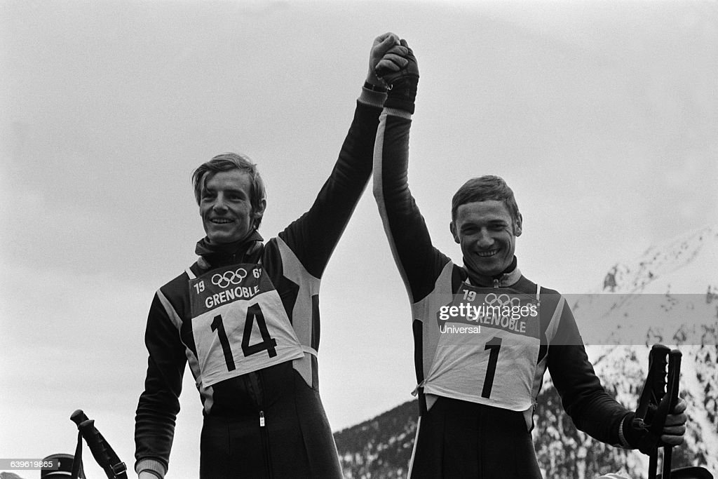 France's <a gi-track='captionPersonalityLinkClicked' href=/galleries/search?phrase=Jean-Claude+Killy&family=editorial&specificpeople=223880 ng-click='$event.stopPropagation()'>Jean-Claude Killy</a> (L) and Guy Perillat (R) celebrate their performances in the men's downhill ski event at the 1968 Winter Olympics in Grenoble. Killy won the gold medal and Perillat finished second, winning the silver.