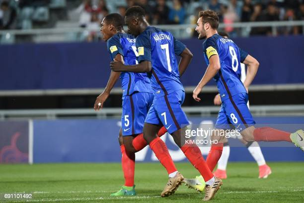 France's JeanKevin Augustin celebrates with teammates Issa Diop and Lucas Tousart after scoring during their U20 World Cup round of 16 football match...