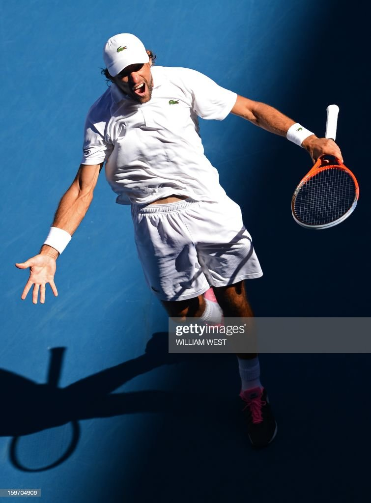 France's Jeremy Chardy celebrates after beating Argentina's Juan Martín Del Potro during their men's singles match on day six of the Australian Open tennis tournament in Melbourne on January 19, 2013. AFP PHOTO / WILLIAM WEST IMAGE STRICTLY RESTRICTED TO EDITORIAL USE - STRICTLY NO COMMERCIAL USE