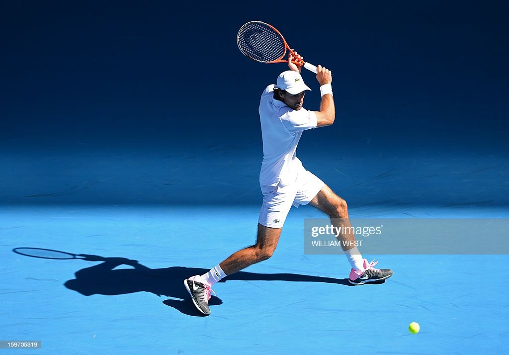 France's Jeremy Chardy hits a return against Argentina's Juan Martín Del Potro during their men's singles match on day six of the Australian Open tennis tournament in Melbourne on January 19, 2013.