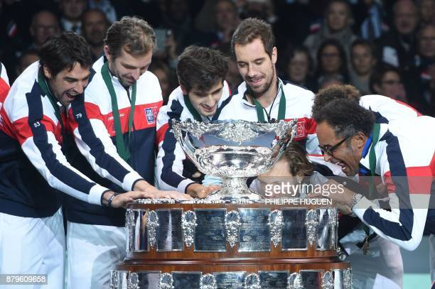 France's Jeremy Chardy Julien Benneteau PierreHugues Herbert Richard Gasquet Lucas Pouille and Yannick Noah pose with the trophy after winning the...