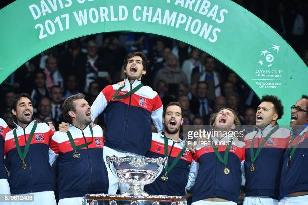 France's Jeremy Chardy Julien Benneteau PierreHugues Herbert Richard Gasquet Lucas Pouille JoWilfried Tsonga and Yannick Noah pose with the trophy...