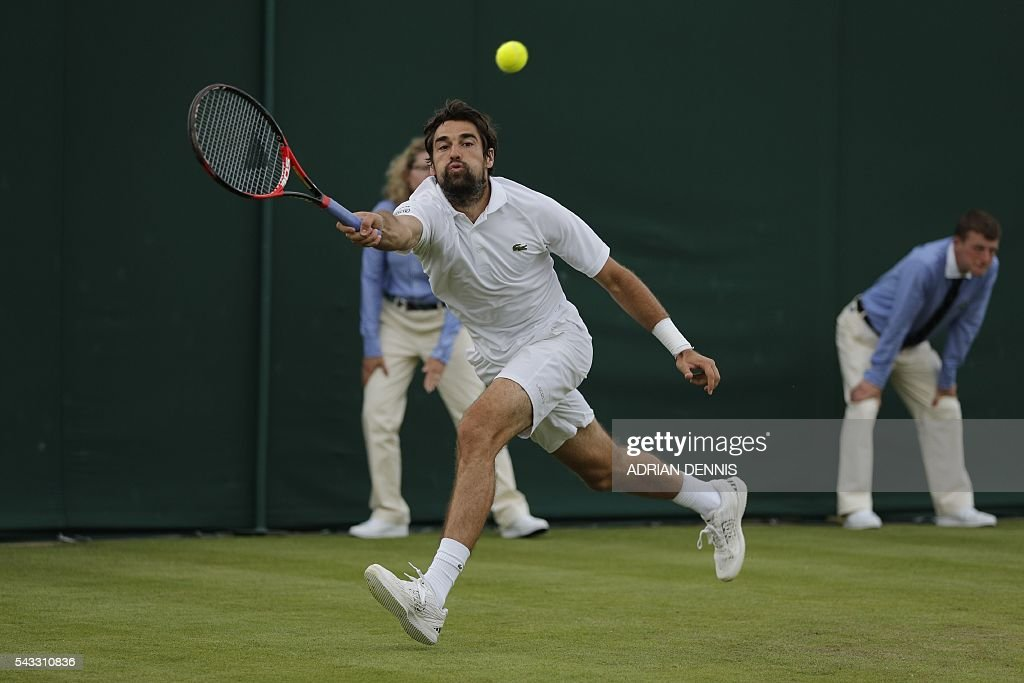 France's Jeremy Chardy returns against France's Gael Monfils during their men's singles first round match on the first ay of the 2016 Wimbledon Championships at The All England Lawn Tennis Club in Wimbledon, southwest London, on June 27, 2016. / AFP / ADRIAN