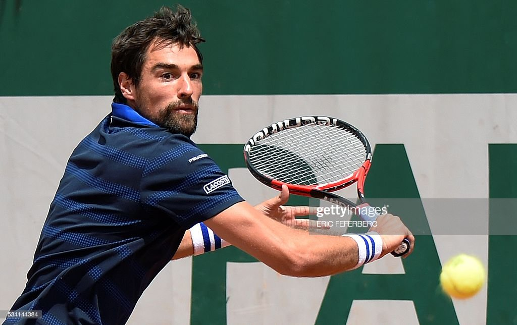 France's Jeremy Chardy returns the ball to Czech Republic's Adam Pavlasek during their men's second round match at the Roland Garros 2016 French Tennis Open in Paris on May 25, 2016. / AFP / Eric FEFERBERG