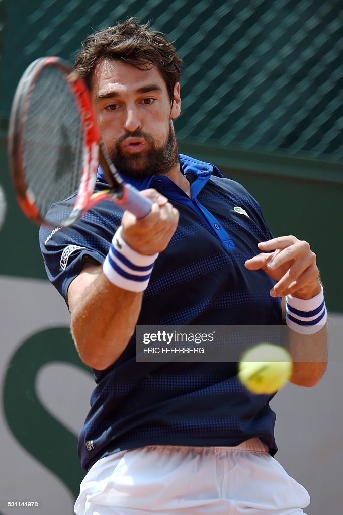 France's Jeremy Chardy returns the ball to Czech Republic's Adam Pavlasek during their men's second round match at the Roland Garros 2016 French Tennis Open in Paris on May 24, 2016. / AFP / Eric FEFERBERG