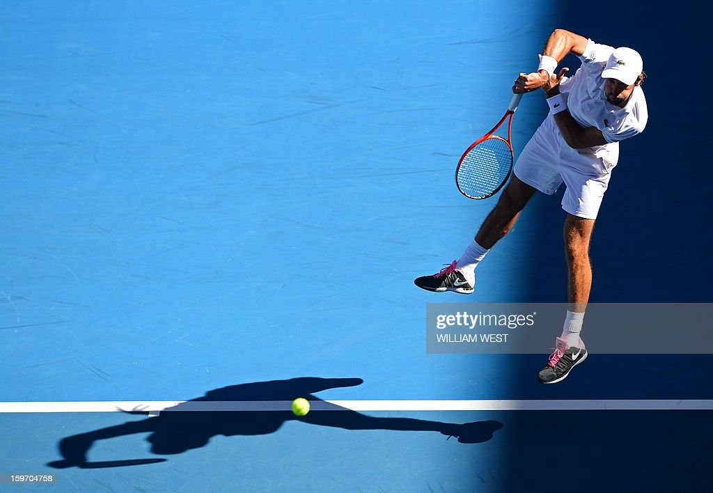 France's Jeremy Chardy serves against Argentina's Juan Martín Del Potro during their men's singles match on day six of the Australian Open tennis tournament in Melbourne on January 19, 2013.