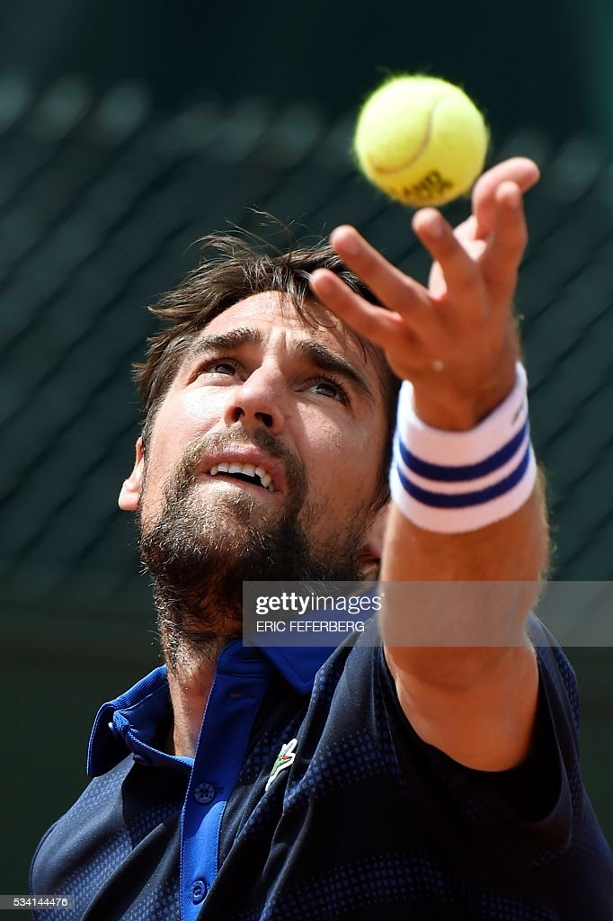 France's Jeremy Chardy serves the ball to Czech Republic's Adam Pavlasek during their men's second round match at the Roland Garros 2016 French Tennis Open in Paris on May 25, 2016. / AFP / Eric FEFERBERG