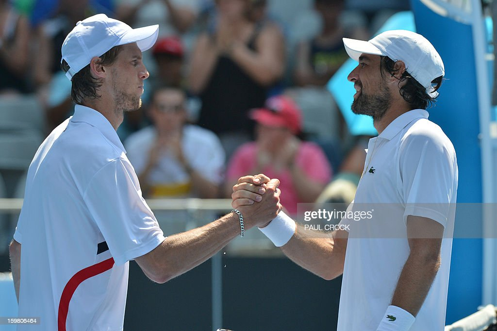 France's Jeremy Chardy (R) shakes hands after victory in his men's singles match against Italy's Andreas Seppi on the eighth day of the Australian Open tennis tournament in Melbourne on January 21, 2013. AFP PHOTO/PAUL CROCK IMAGE STRICTLY RESTRICTED TO EDITORIAL USE - STRICTLY NO COMMERCIAL USE
