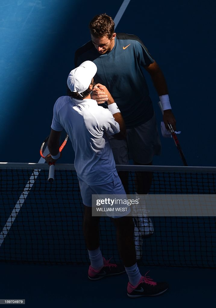 France's Jeremy Chardy (L) shakes hands with Argentina's Juan Martín Del Potro after his victory during their men's singles match on day six of the Australian Open tennis tournament in Melbourne on January 19, 2013.