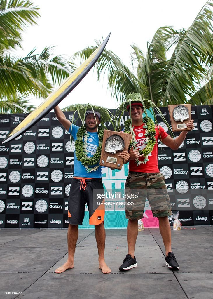 France's Jeremy Flores and Brazil's Gabriel Medina pose with their trophies after the 2015 Billabong Pro Tahiti World Surf league tour n°3 along the...