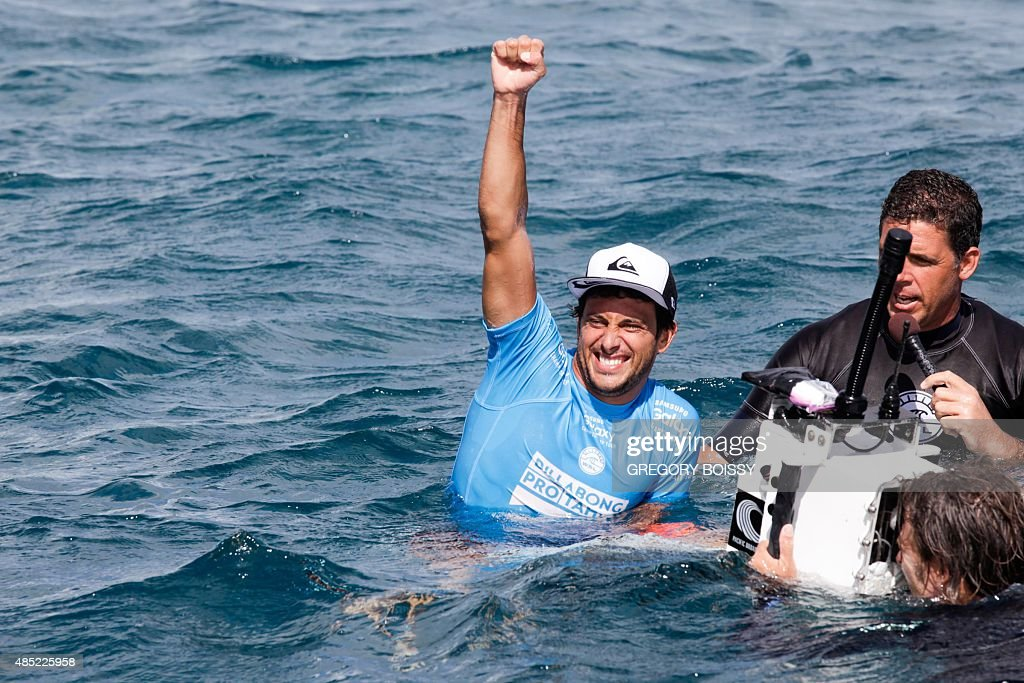 France's Jeremy Flores reacts after winning the 2015 Billabong Pro Tahiti World Surf league tour n°3 along the Teahupo'o coast western of the French...