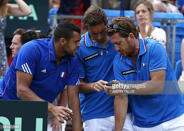 France's Jo Wilfried Tsonga and Nicolas Mahut talk tactics during the singles game between France's Gilles Simon and Britain's Andy Murray in a Davis...
