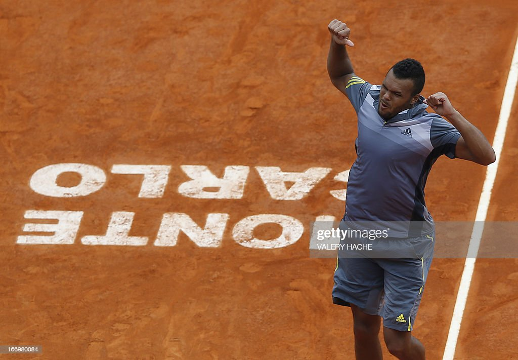 France's Jo Wilfried Tsonga celebrates after winning his match against Switzerland's Stanislas Wawrinka during a Monte-Carlo ATP Masters Series Tournament tennis match on April 19, 2013 in Monaco. Tsonga won 2-6, 6-3, 6-4 HACHE