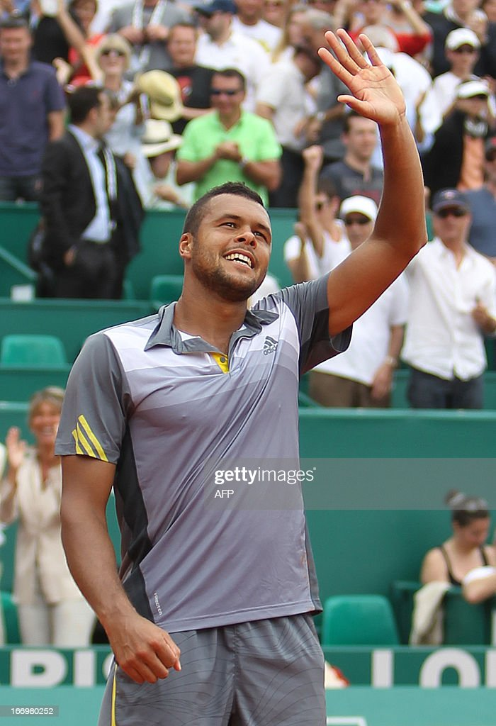 France's Jo Wilfried Tsonga celebrates after winning his match against Switzerland's Stanislas Wawrinka during a Monte-Carlo ATP Masters Series Tournament tennis match on April 19, 2013 in Monaco. Tsonga won 2-6, 6-3, 6-4 MAGNENET