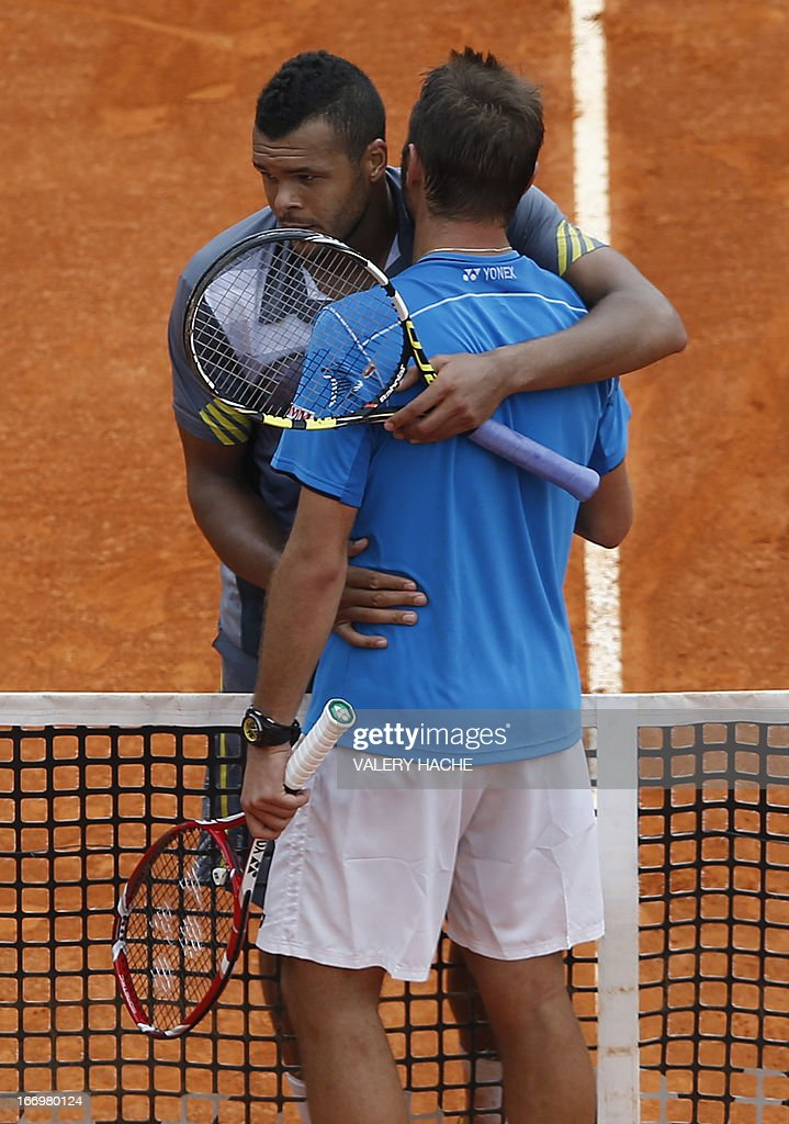 France's Jo Wilfried Tsonga (L) embraces Switzerland's Stanislas Wawrinka at the end of his match during a Monte-Carlo ATP Masters Series Tournament tennis match on April 19, 2013 in Monaco. Tsonga won 2-6, 6-3, 6-4.