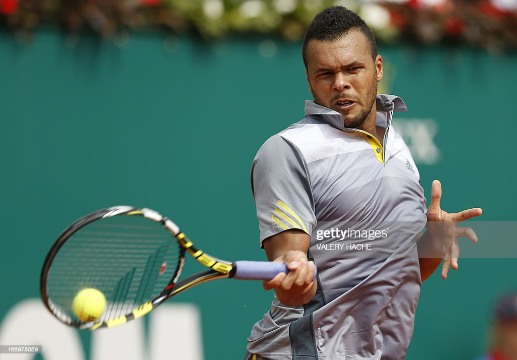 France's Jo Wilfried Tsonga hits a return to Switzerland's Stanislas Wawrinka during a Monte-Carlo ATP Masters Series Tournament tennis match on April 19, 2013 in Monaco.