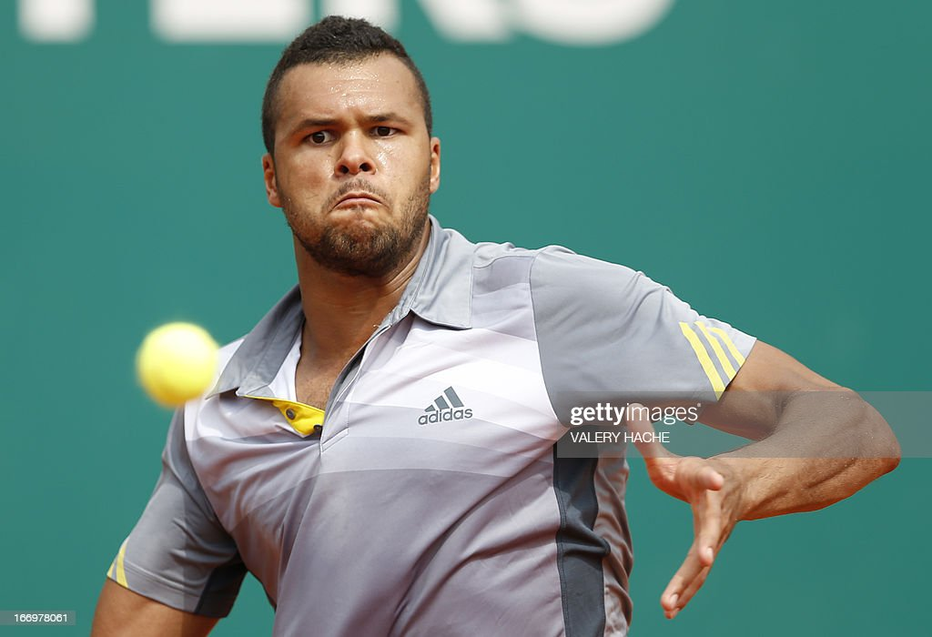 France's Jo Wilfried Tsonga hits a return to Switzerland's Stanislas Wawrinka during a Monte-Carlo ATP Masters Series Tournament tennis match on April 19, 2013 in Monaco. AFP PHOTO/ VALERY HACHE