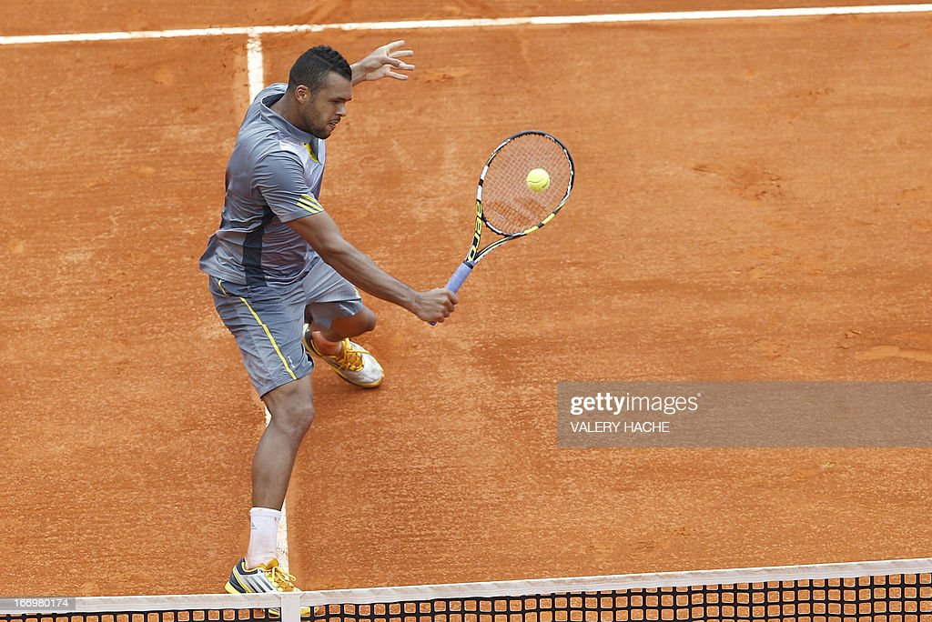 France's Jo Wilfried Tsonga hits a return to Switzerland's Stanislas Wawrinka during a Monte-Carlo ATP Masters Series Tournament tennis match on April 19, 2013 in Monaco. Tsonga won 2-6, 6-3, 6-4. HACHE