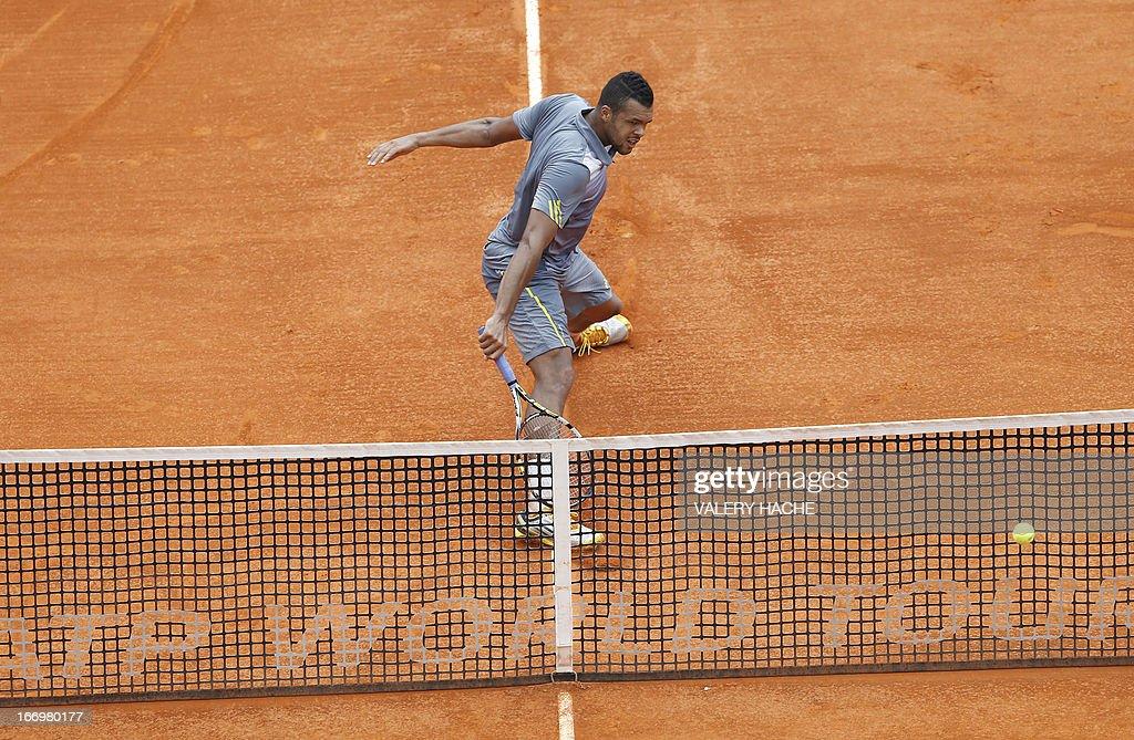 France's Jo Wilfried Tsonga hits a return to Switzerland's Stanislas Wawrinka during a Monte-Carlo ATP Masters Series Tournament tennis match on April 19, 2013 in Monaco. Tsonga won 2-6, 6-3, 6-4. HACHE