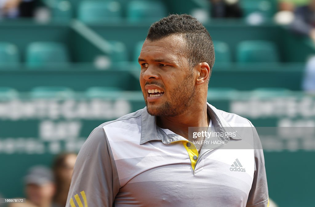France's Jo Wilfried Tsonga reacts during his match against Switzerland's Stanislas Wawrinka during a Monte-Carlo ATP Masters Series Tournament tennis match on April 19, 2013 in Monaco.