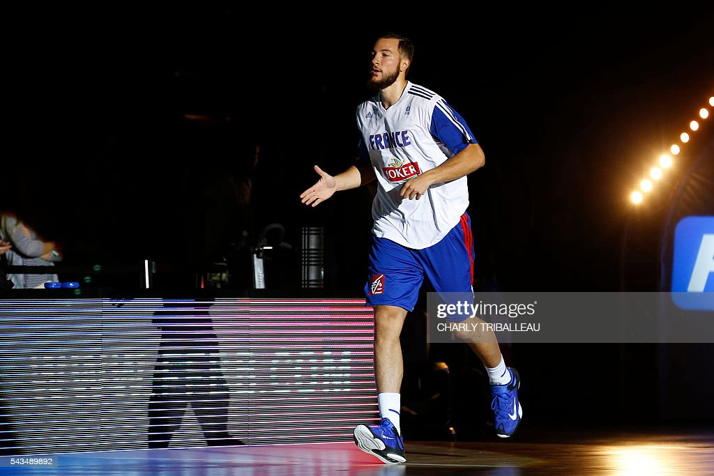 France's Joffrey Lauvergne enters the pitch before the basketball match between France and Japan at the Kindarena hall in Rouen on June 28, 2016. / AFP / CHARLY