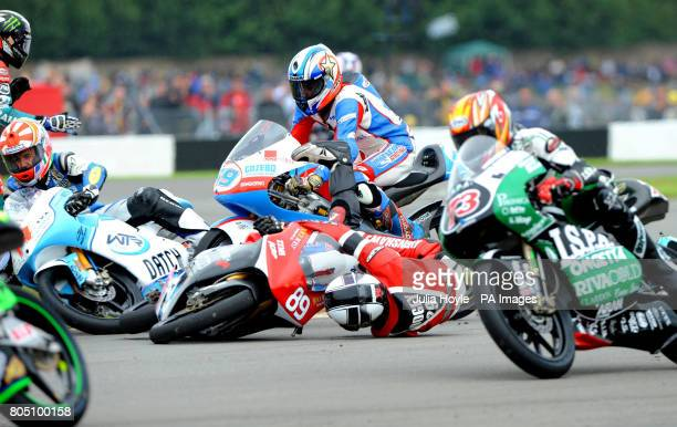 France's Johann Zarco and Great Britain's James Lodge crash on the Esses in the 125cc race during the British Grand Prix at Donington Park Castle...