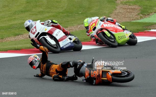 France's Johann Zarco crashes during the British Moto 2 Grand Prix at Silverstone Circuit Northamptonshire