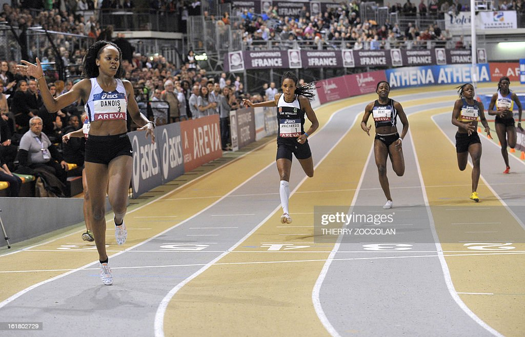 France's Johanna Danois (L) reacts after winning the women's 200m race at the 2013 French Indoor Athletics championships on February 16, 2013 in Aubiere, central France. ZOCCOLAN