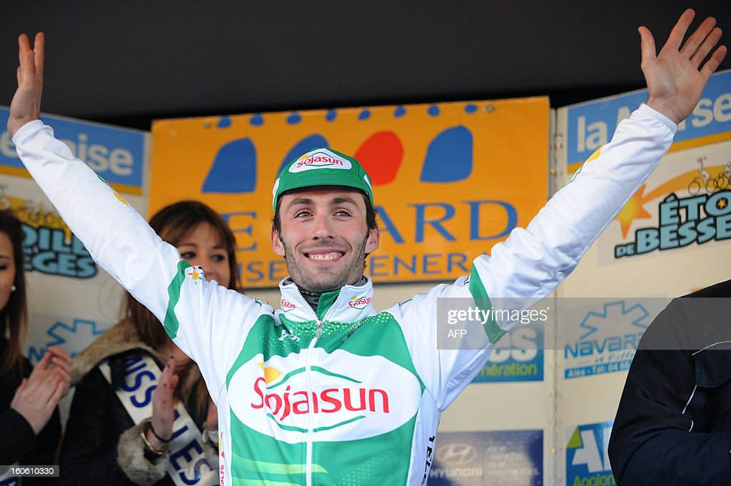 France's Jonathan Hivert celebrates on the podium after winning the 43rd Etoile de Besseges cycling race on February 3, 2013 in Ales, southern France.