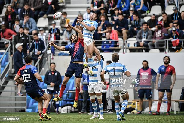 France's Jonathan Laugel Argentina's Axel Muller during a HSBC Paris Sevens Series rugby match between Argentina and France at the Stade Jean Bouin...