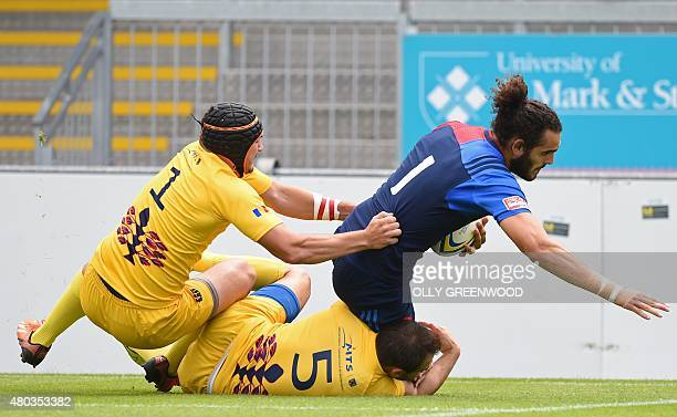France's Jonathan Laugel scores a try against Romania during the European Rugby Sevens Grand Prix Series rugby union tournament at Sandy Park Exeter...