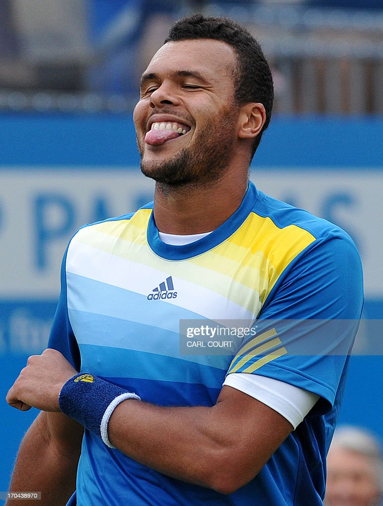 France's Jo-Wilfried Tsonga celebrates after beating compatriot Edouard Roger-Vasselin in their ATP Aegon Championships tennis match at the Queen's Club in west London on June 13, 2013. AFP PHOTO / CARL COURT