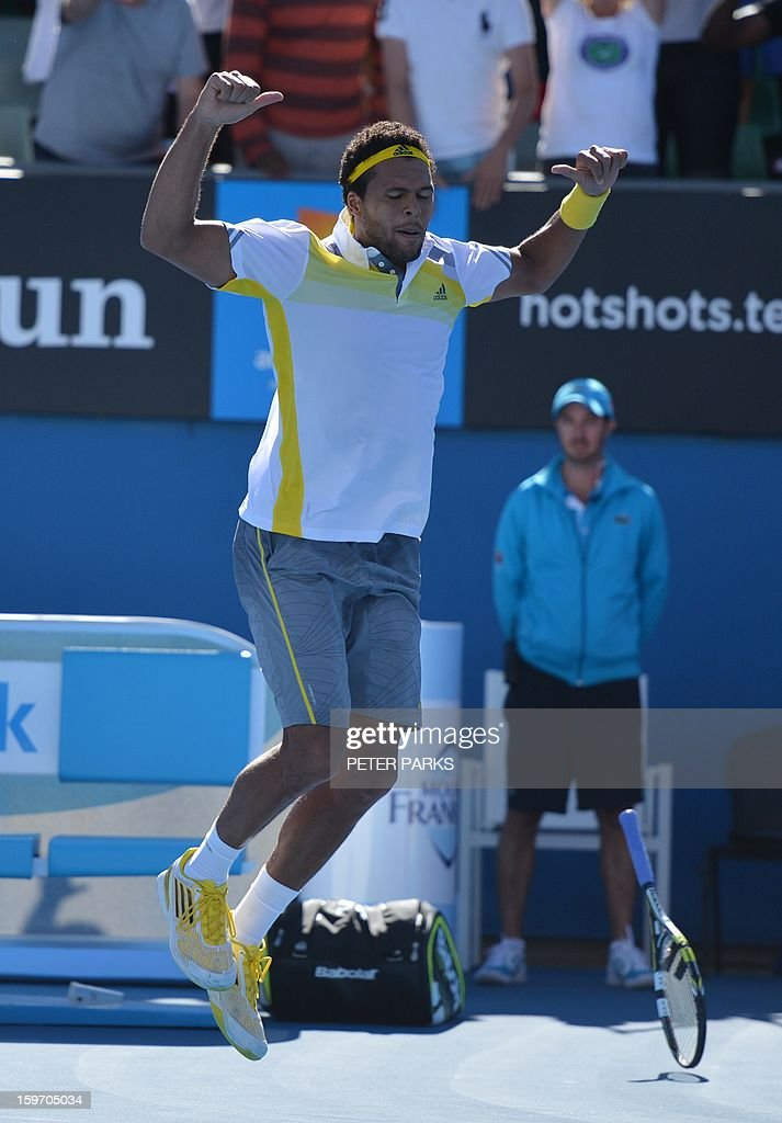 France's Jo-Wilfried Tsonga celebrates after beating Slovenia's Blaz Kavcic during their men's singles match on day six of the Australian Open tennis tournament in Melbourne on January 19, 2013. AFP PHOTO / PETER PARKS IMAGE STRICTLY RESTRICTED TO EDITORIAL USE - STRICTLY NO COMMERCIAL USE