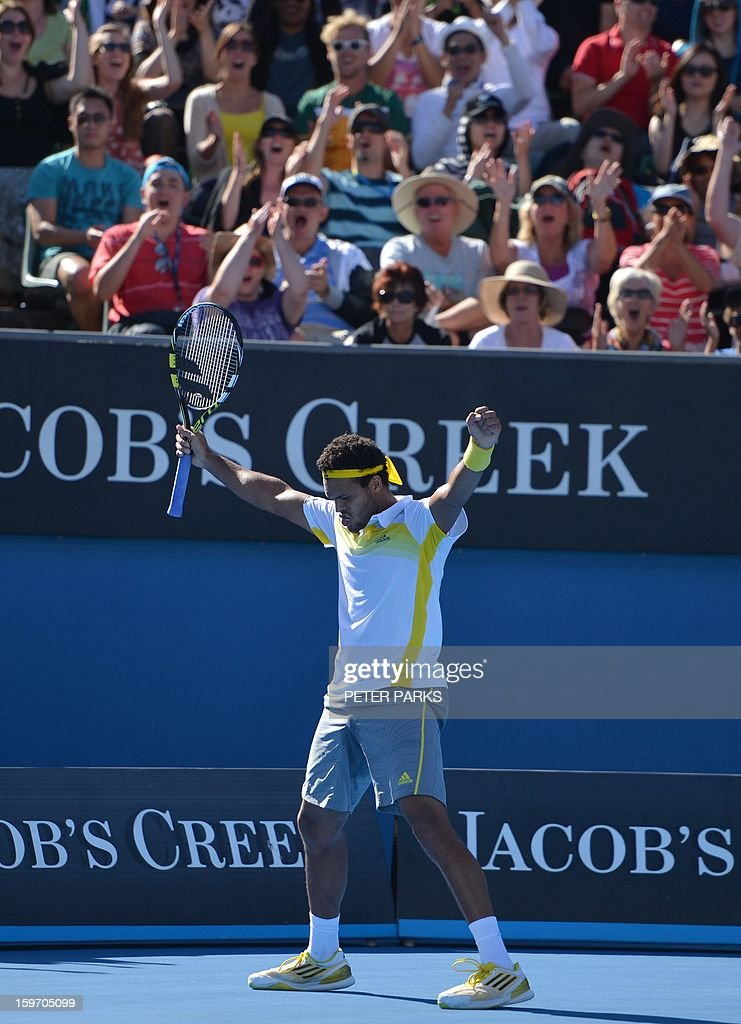 France's Jo-Wilfried Tsonga celebrates after beating Slovenia's Blaz Kavcic during their men's singles match on day six of the Australian Open tennis tournament in Melbourne on January 19, 2013.