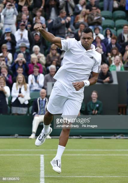 France's JoWilfried Tsonga celebrates beating Belgium's David Goffin during day one of the Wimbledon Championships at The All England Lawn Tennis and...