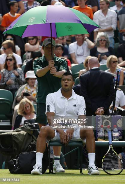 France's JoWilfried Tsonga during a break in his match against Latvia's Ernests Gulbis during day Three of the Wimbledon Championships at The All...