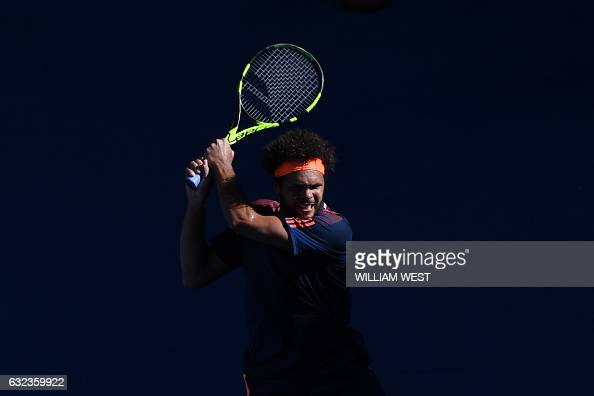 TOPSHOT France's JoWilfried Tsonga hits a return against Britain's Daniel Evans during their men's singles fourth round match on day seven of the...