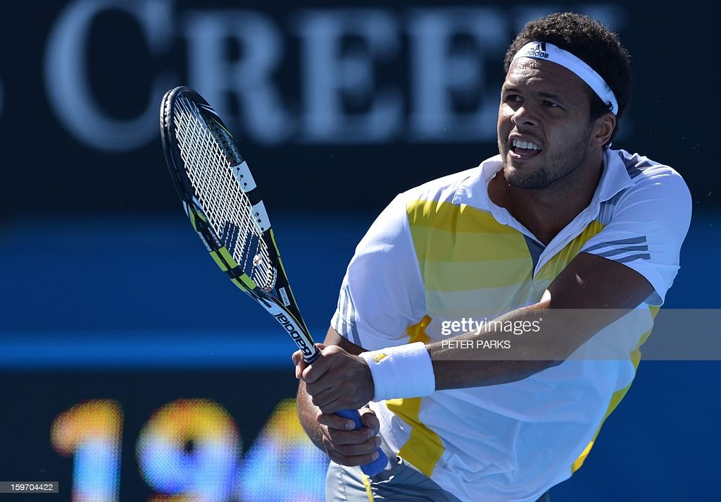 France's Jo-Wilfried Tsonga hits a return against Slovenia's Blaz Kavcic during their men's singles match on day six of the Australian Open tennis tournament in Melbourne on January 19, 2013.
