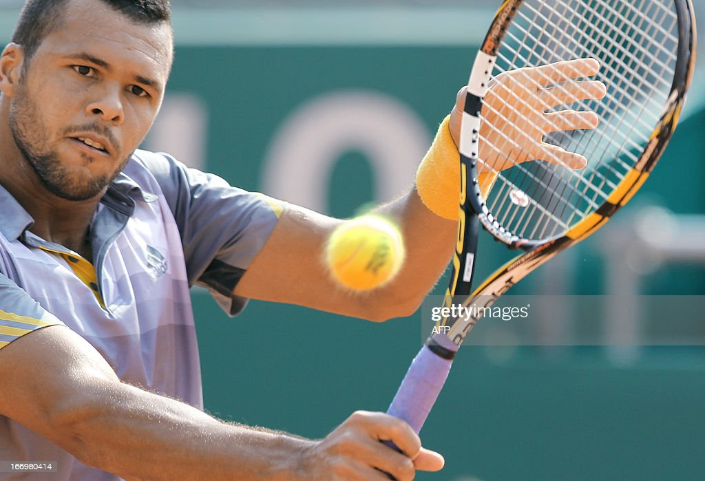 France's Jo-Wilfried Tsonga hits a return during his match against Switzerland's Stanislas Wawrinka at the Monte-Carlo ATP Masters Series Tennis Tournament on April 19, 2013 in Monaco.