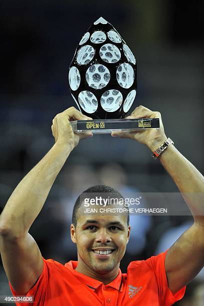 France's JoWilfried Tsonga holds his trophy after defeating France's Gilles Simon during the ATP Moselle Open finals tennis match on September 27...