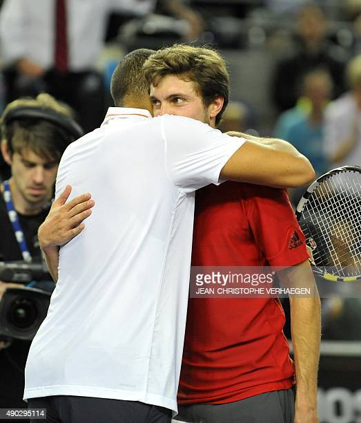 France's JoWilfried Tsonga hugs France's Gilles Simon after winning the ATP Moselle Open finals tennis match on September 27 2015 in Metz eastern...