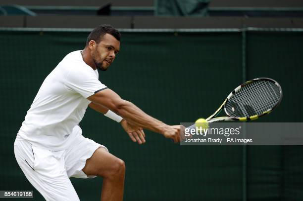France's JoWilfried Tsonga in action against Austria's Jurgen Melzer during day one of the Wimbledon Championships at the All England Lawn Tennis and...