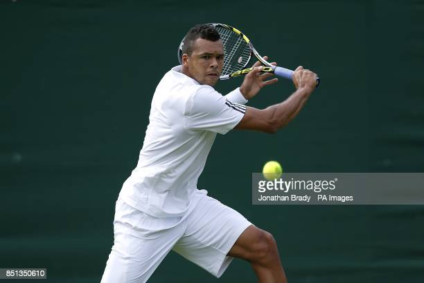 France's JoWilfried Tsonga in action against Belgium's David Goffin during day one of the Wimbledon Championships at The All England Lawn Tennis and...