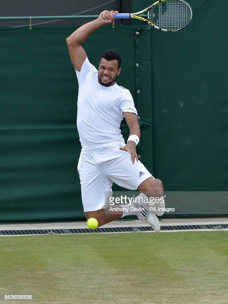 France's JoWilfried Tsonga in action against ChineseTaipei's Jimmy Wang during day five of the Wimbledon Championships at the All England Lawn Tennis...